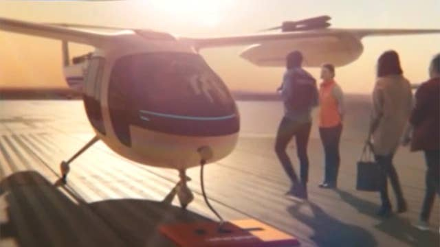 Uber unveils design models for its new air taxi