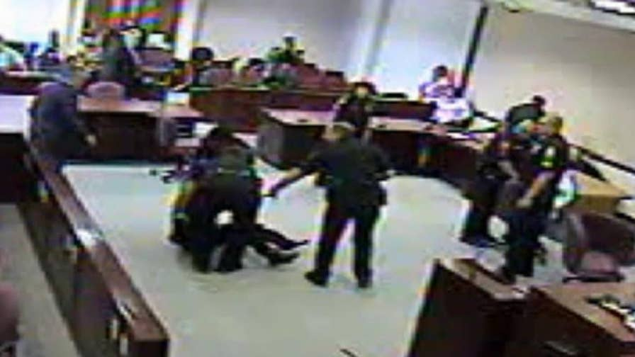 Video released by the Marion County Sheriff's Office shows three co-defendants fighting with their own attorneys and bailiffs after the verdict was handed down.
