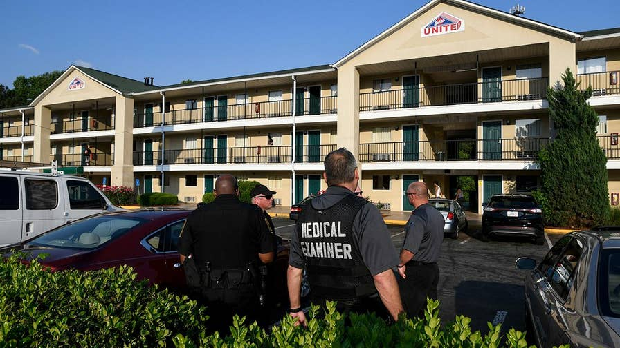 Three Georgia police officers are hospitalized after coming into a chemical while investigating a dead body in a motel room.
