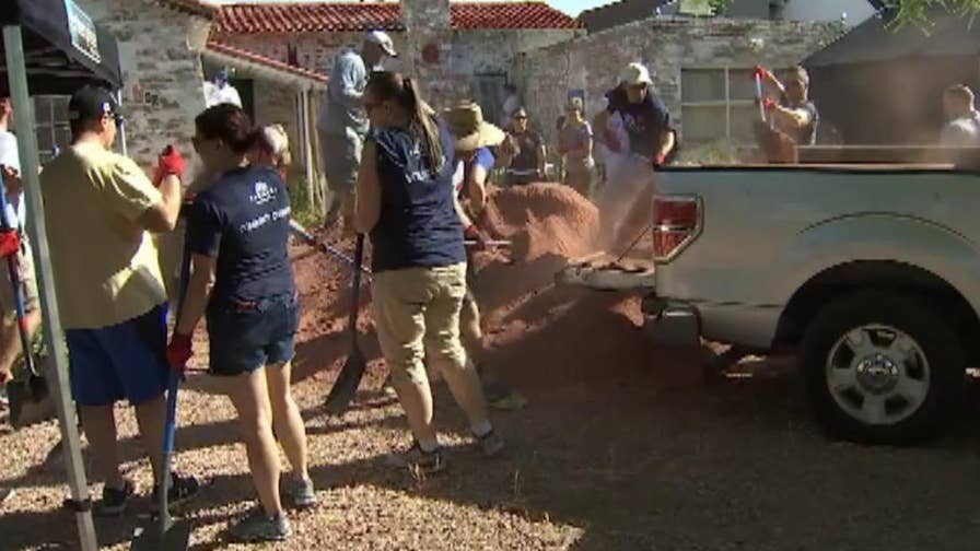 Nearly 100 volunteers came together in Arizona to help improve the home of a Korean War veteran.