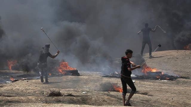 Dozens dead in clashes on Gaza border