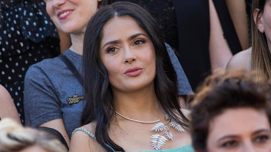 Eighty-two women, including actresses Cate Blanchett and Salma Hayek, walked the red carpet in solidarity and gathered on the stairs as part of a symbolic gesture.