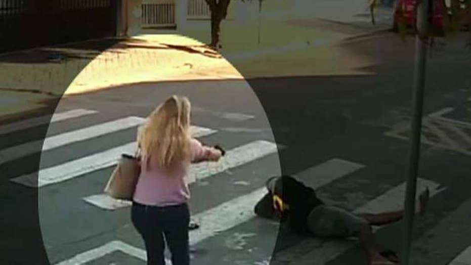 Off-duty cop shoots gunman near a school in Brazil
