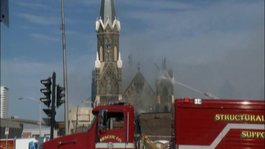 Flames burned through the roof of Trinity Evangelical Lutheran Church, authorities are investigating the cause of the fire.