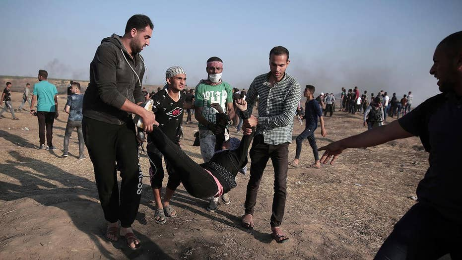 Violence at Gaza border subsides as Palestinians mourn dead