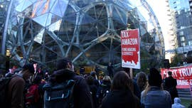 Amazon, Starbucks, Vulcan and other companies have pledged a total of more than $350,000 toward an effort to repeal Seattle's newly passed tax on large employers intended to combat homelessness.