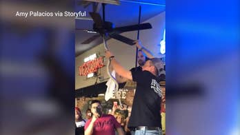 Staff members at the Backyard, a bar, grill and music venue in Waco, Texas, were forced to remove a snake from the establishment after the creature somehow entangled itself in the ceiling fan, all while concerned customers can be heard gasping and screaming.