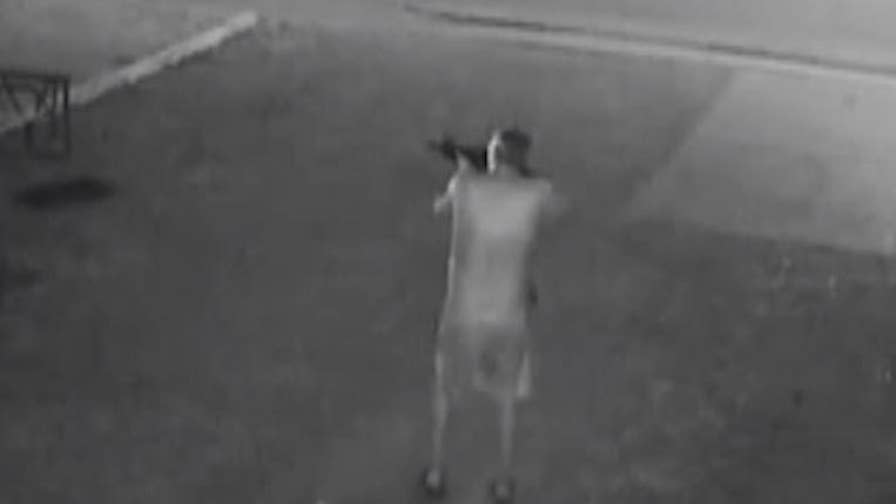 Surveillance footage shows a gunman firing an AR-15 at police officers in Evansville, Indiana.
