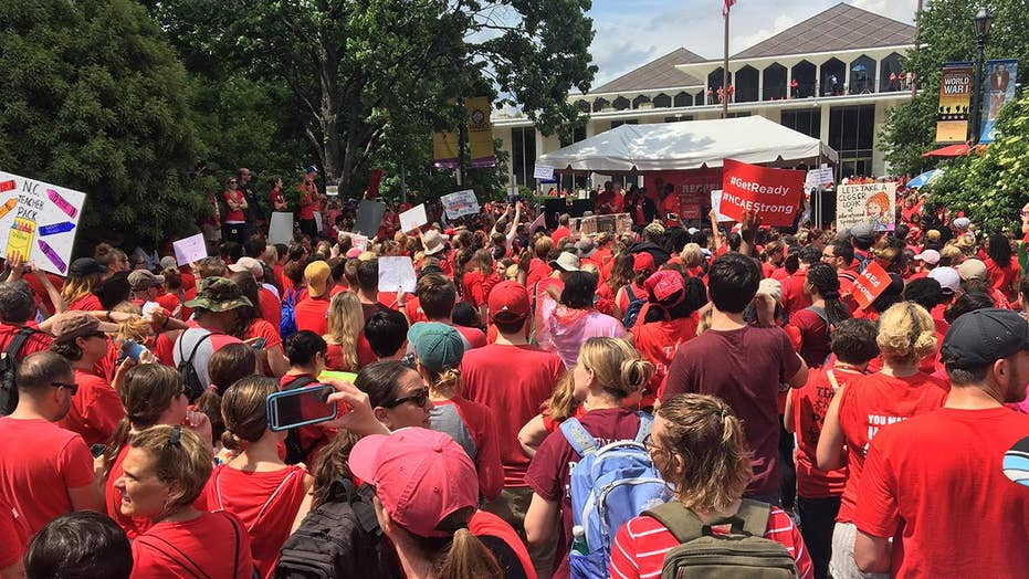 North Carolina's capital flooded by sea of teachers in red