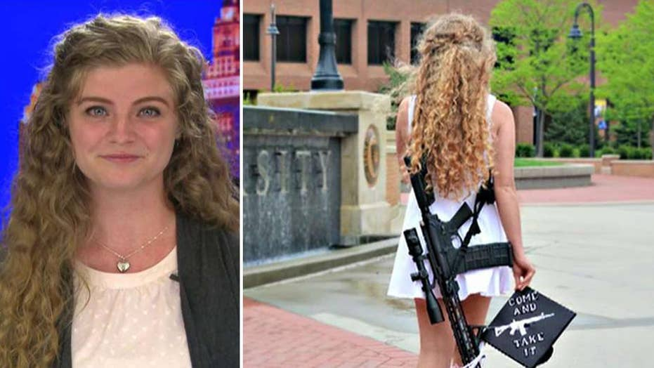 Kent State graduate poses with rifle on campus