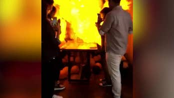 Video captures the moment balloons filled with hydrogen explode after a woman lights a birthday cake in Mysore, India.