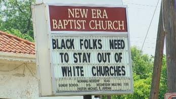 Signage outside New Era Baptist Church turns heads in Birmingham, Alabama.