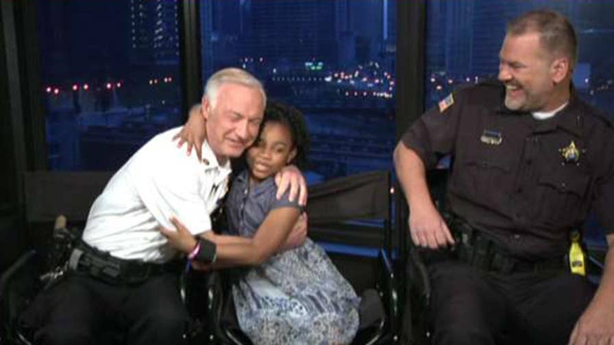 Rosalyn Baldwin's goal is to hug police officers in each state. 8-year-old was inspired by attacks on cops.