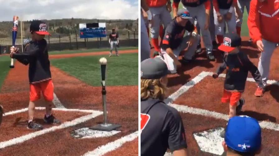 Raw video: Air Force Academy and University of New Mexico baseball teams help Lio Ortega, who's battling brain cancer, hit a home run before their game in Colorado Springs.