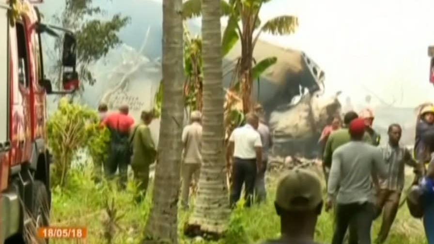 Raw video: Smoke rises from the wreckage as first responders rush to the scene of a Boeing 737 plane crash in Cuba.
