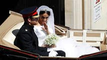 Horse-drawn Ascot Landau carriage carries Prince Harry and Meghan Markle from St. George's Chapel to Windsor Castle for their reception.