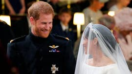 A source opens up to ET about some touching moments at the couple's lunchtime reception at St. George's Hall in Windsor Castle that was hosted by Harry's grandmother, Queen Elizabeth II.