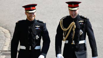 Royal groom and his best man greet cheering well-wishers in Windsor, England as they crossed the grounds of the 15th-century church for Prince Harry's royal wedding American actress Meghan Markle.