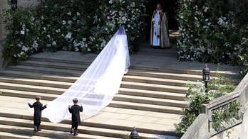 Cheering crowds, church bells greet the American actress as she arrives at St. George's Chapel in Windsor, England for her wedding to Prince Harry.