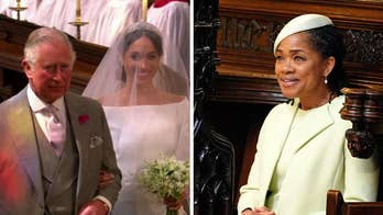 Prince Harry's father escorts bride in St. George's Chapel in Windsor for the royal wedding.