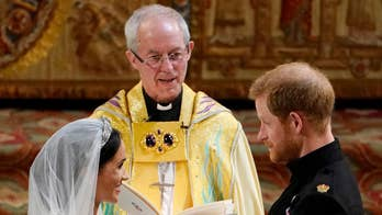 Royal couple exchange vows, rings at royal wedding in St. George's Chapel, Windsor.