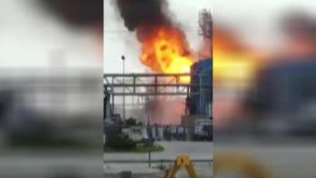Video shows industrial flash fire at plant near Pasadena, Texas.