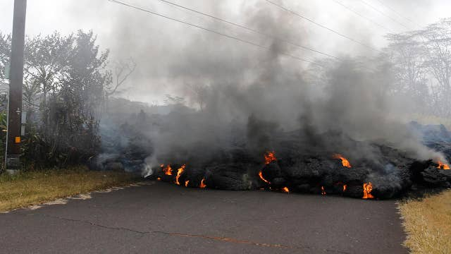Hawaii officials rescue at least four people from lava flow