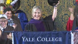 Early in her address to graduating Yale students at Sunday's Class Day, Hillary Clinton reached behind the lectern, pulled out a traditional Russian ushanka hat, and held it aloft.