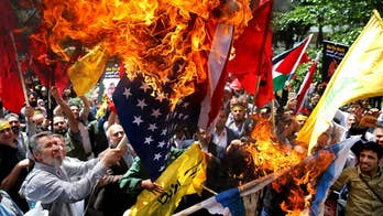 The EU tries to keep Iran deal as demonstrations continue.