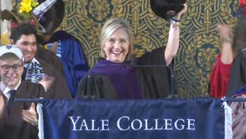 While delivering the 2018 commencement address at Yale, Hillary Clinton holds up a Russian hat for the crowd.