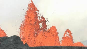 Lava flows from volcano in Hawaii.