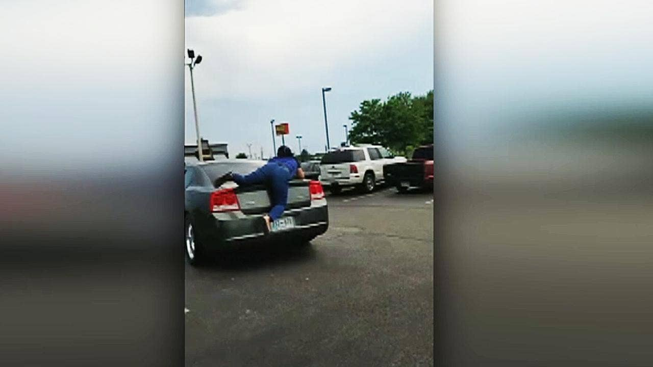 Viral video captures nail salon worker jumping onto car in parking ...