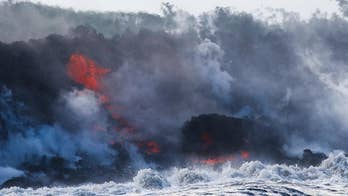 Lava flows also seep over an important highway in Hawaii. Jeff Paul reports.