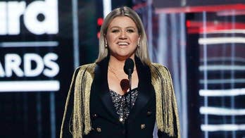 "Billboard Music Awards host, Kelly Clarkson, opened up the show with a tribute to those who died on Friday in the mass shooting at Santa Fe high school in Texas that left ten people dead after a gunman opened fire. The ""American Idol"" star called for a ""moment of action"" and said the U.S. should ""change what's happening."""