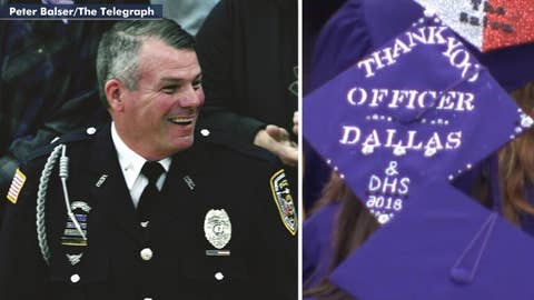 Hero school officer who stopped gunman honored at graduation