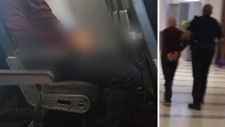 Disorderly Frontier passenger pees on seat in front of him