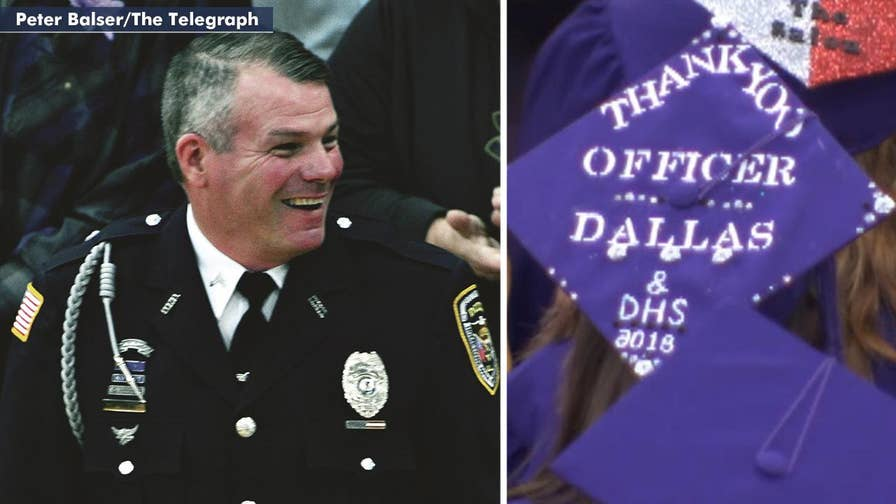Resource officer Mark Dallas given standing ovation at graduation after stopping shooter at Dixon High School earlier in the week.