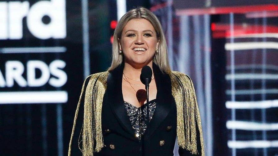 """Billboard Music Awards host, Kelly Clarkson, opened up the show with a tribute to those who died on Friday in the mass shooting at Santa Fe high school in Texas that left ten people dead after a gunman opened fire. The """"American Idol"""" star called for a """"moment of action"""" and said the U.S. should """"change what's happening."""""""