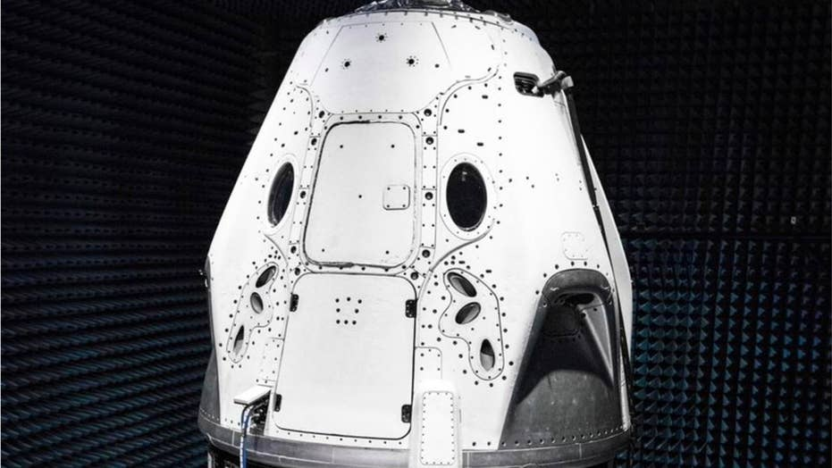 Elon Musk unveils new SpaceX Dragon