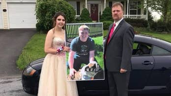 A bittersweet moment as Robert Brown, whose son Carter died in a car crash in April, took Kaylee Suders, his son's girlfriend, to the high school prom she was expecting to attend with Carter.