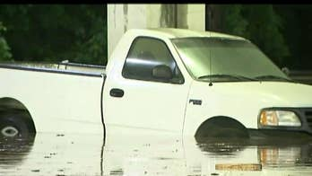 Up to four inches of rain is flooding streets and stalling cars, prompting water rescues.
