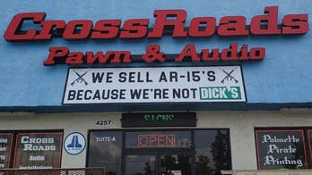 The Crossroads Pawn and Audio shop has posted a controversial sign in front of its store poking fun at the major retailer Dick's Sporting Goods.