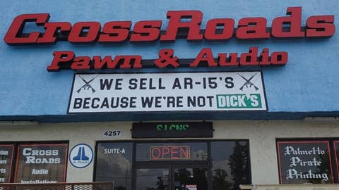 Pawn shop trolls Dick's Sporting Goods with sign