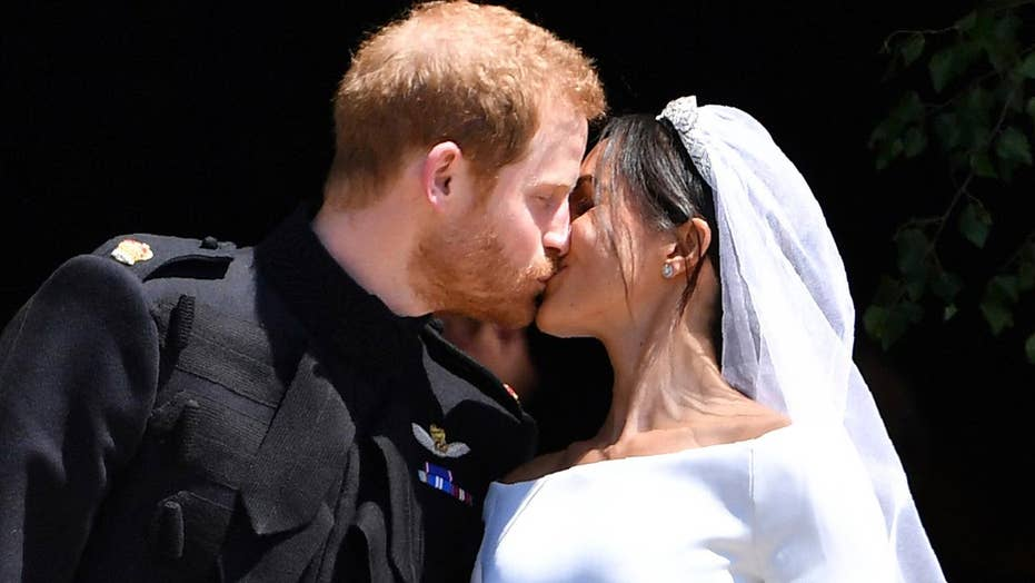 Prince Harry, Meghan Markle seal royal wedding with a kiss