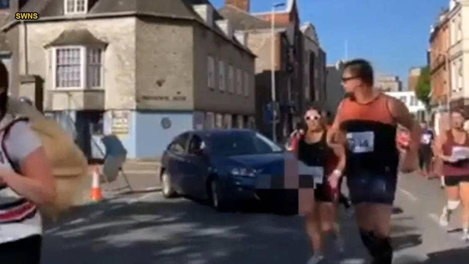 Angry woman drives car into path of half marathon