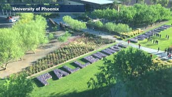 Time-lapse video: the University of Phoenix pays tribute to fallen service members by planting flags for Memorial Day.