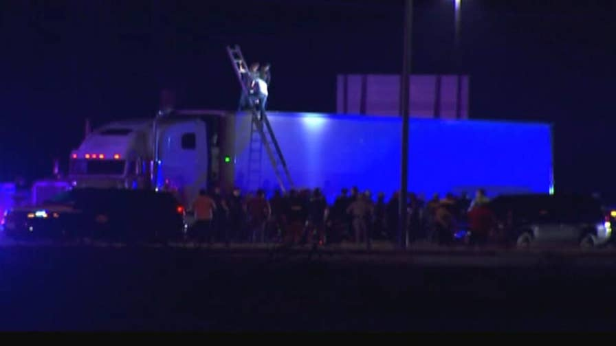 Police discover a tractor trailer full of undocumented immigrants in Raymondville, Texas, less than 50 miles from the Mexican border.