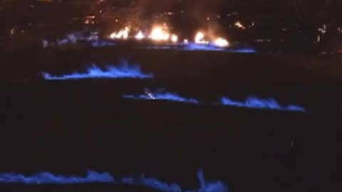 Eerie blue flames emerge from Hawaii volcano