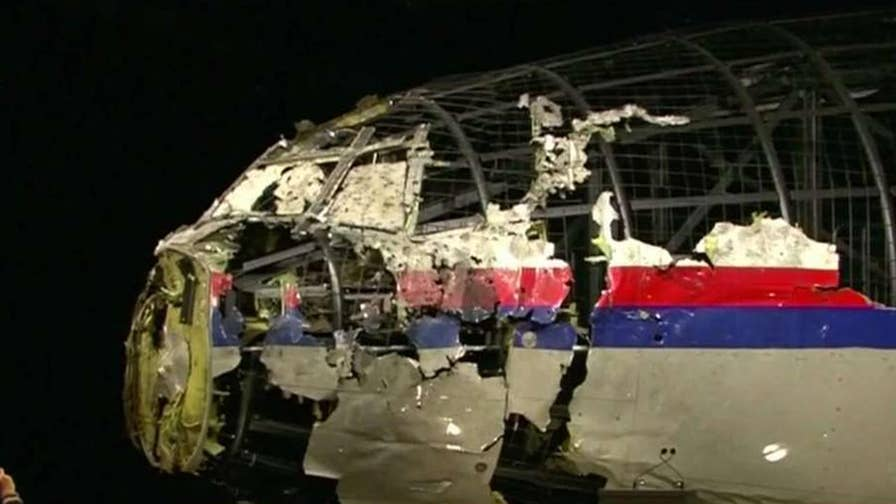 International investigators say a Russian convoy carried Buk missile into Ukraine before shooting down Malaysia Airlines Flight 17; Benjamin Hall reports.