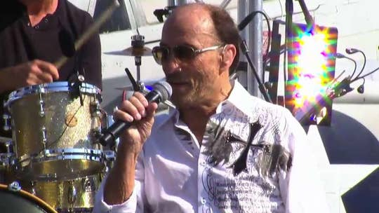 Country music legend performs the iconic song on the Intrepid.